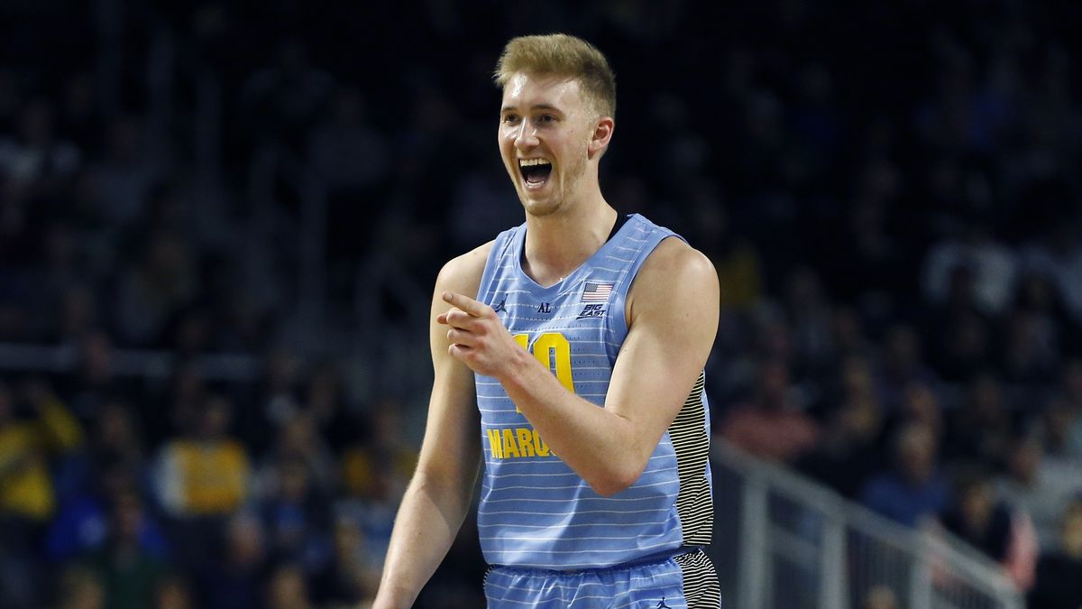 FILE - In this Feb. 23, 2019, file photo, Marquette's Sam Hauser reacts after scoring during...