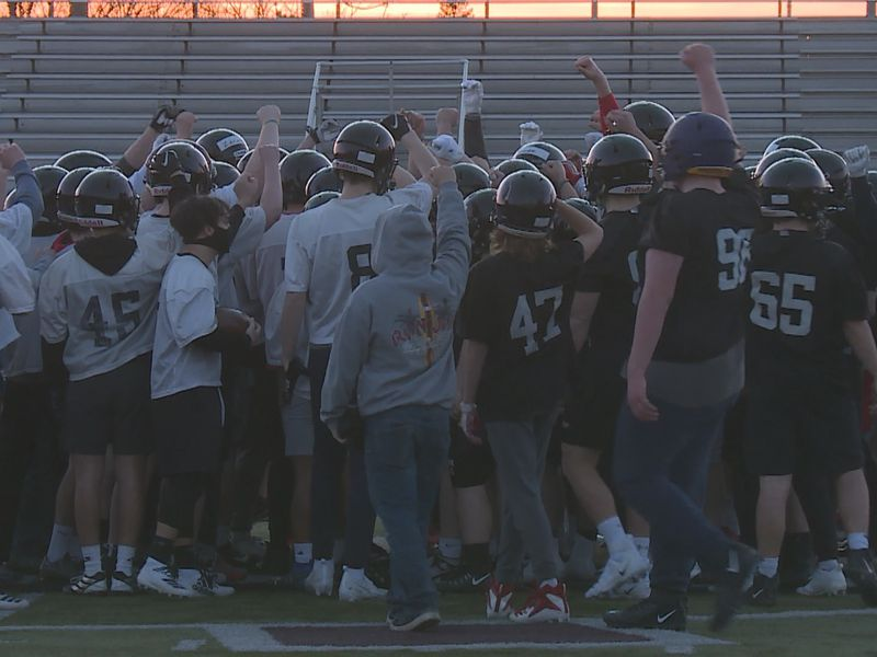 The SPASH Football team huddles up after their first practice of the spring on March 8, 2021.