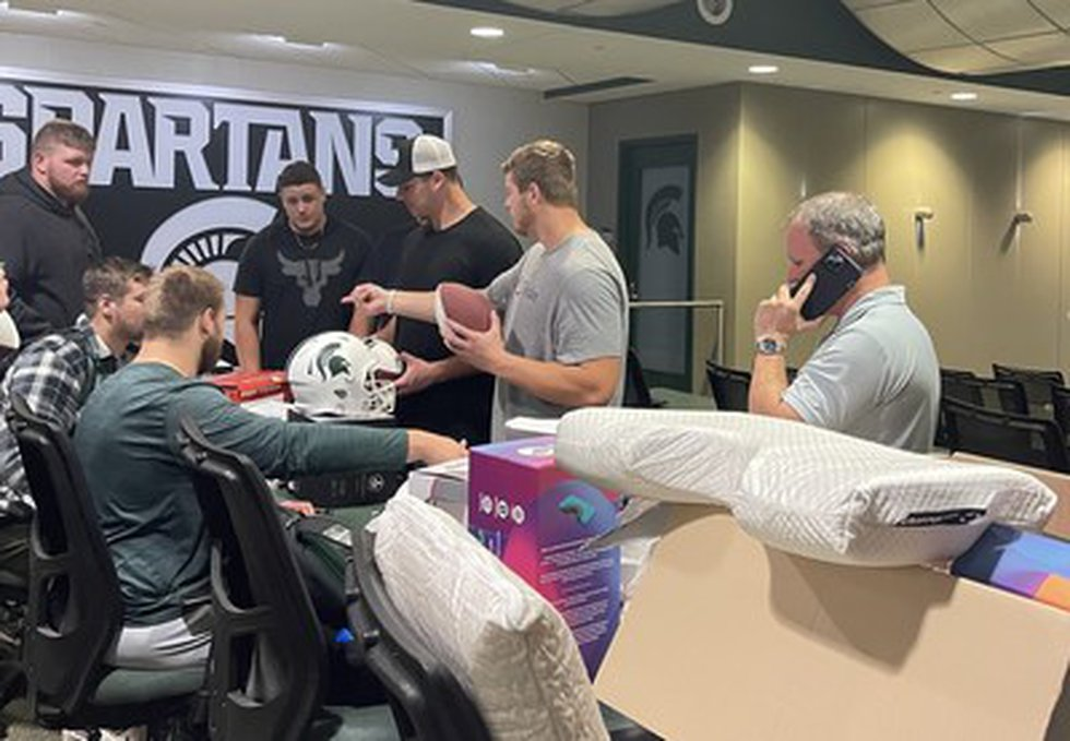 The Michigan State Offensive Line being fit for Pillows by Dennis Gartland President of...