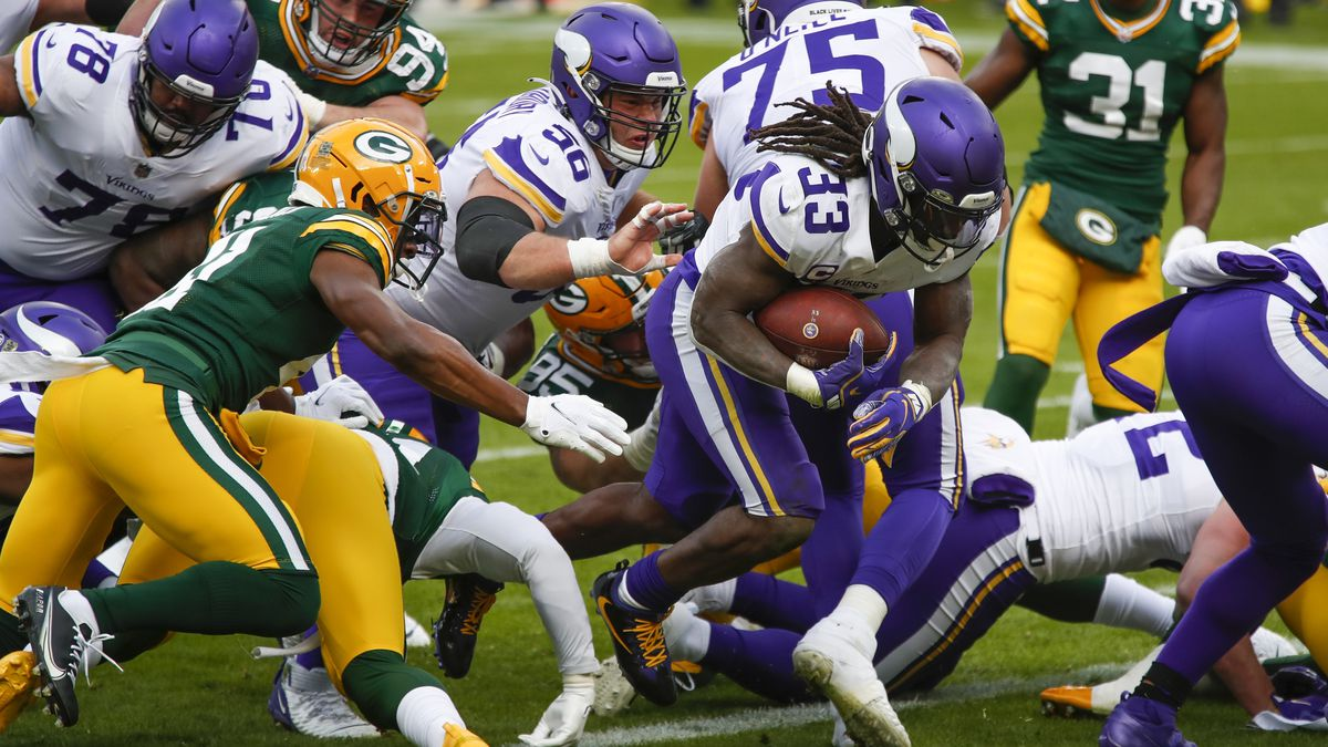 Minnesota Vikings' Dalvin Cook runs for a touchdown during the first half of an NFL football...