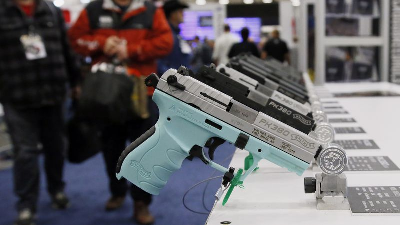 FILE - In this May 4, 2018 file photo, handguns are on display at the National Rifle...