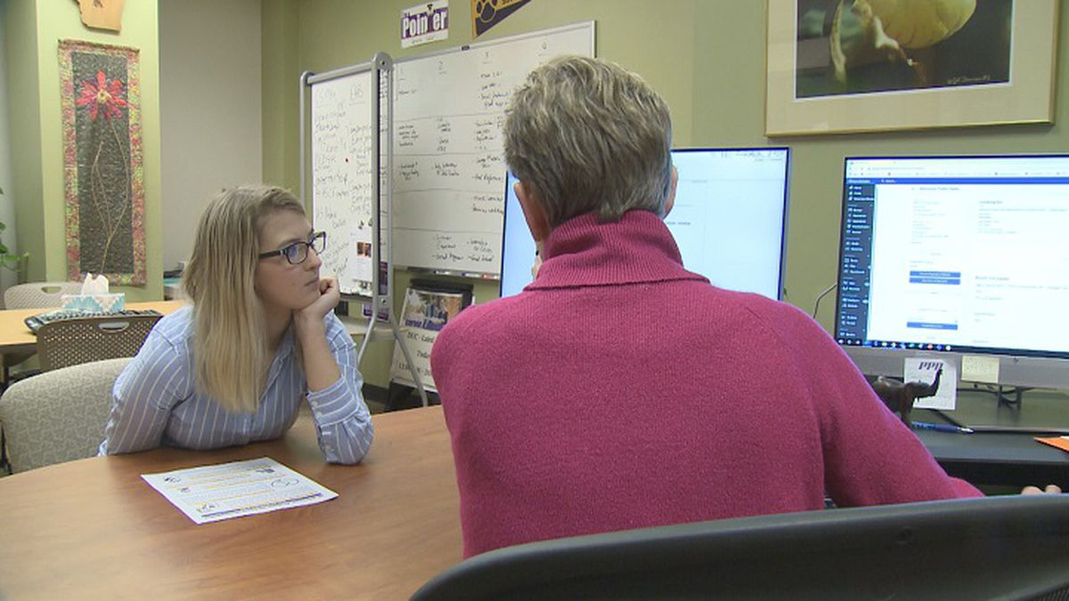 Student discusses her resume with Career Services at UW-Stevens Point (WSAW photo)