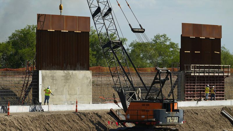 Construction workers build a border wall in Mission, Texas, Monday, Nov. 16, 2020....