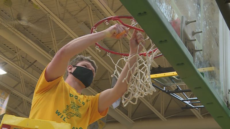 Edgar senior Kyle Brewster cutting down the nets after a sectional final win over Clear Lake.
