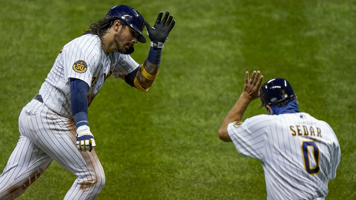 Milwaukee Brewers' Jacob Nottingham celebrates his two-run home run with third base coach Ed Sedar during the sixth inning of the second game of a baseball doubleheader against the St. Louis Cardinals Wednesday, Sept. 16, 2020, in Milwaukee. (AP Photo/Morry Gash)