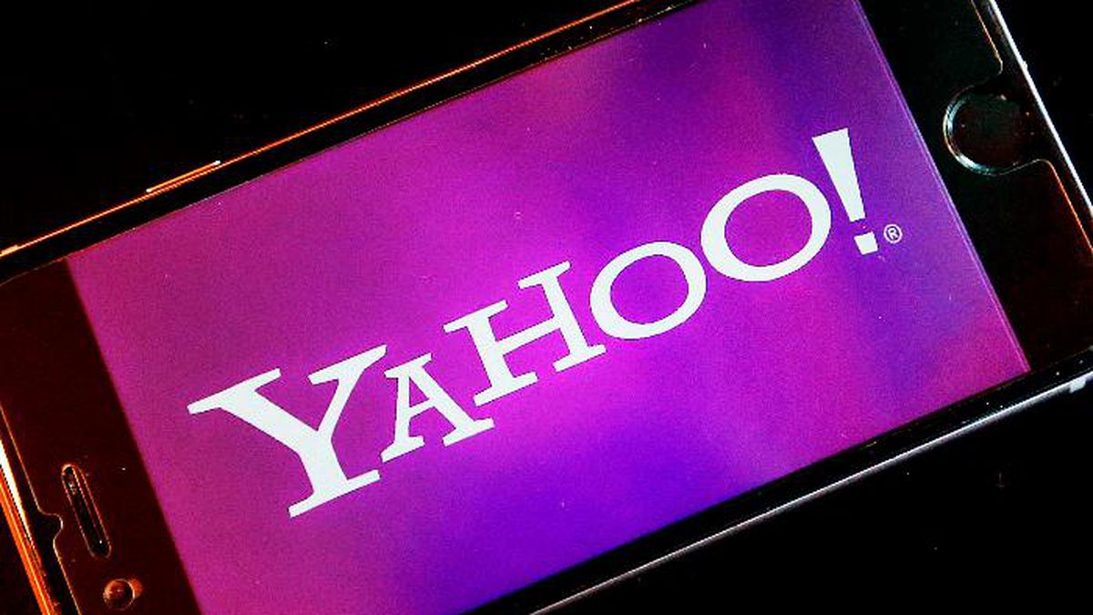 FILE - In this Dec. 15, 2016, file photo, the Yahoo logo appears on a smartphone in Frankfurt....