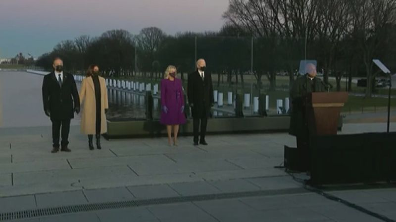 The president and vice president stand for  memorial on the eve of inauguration.