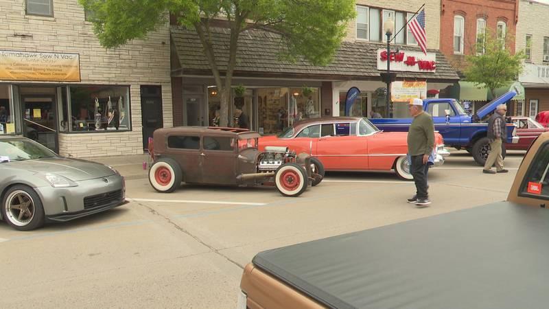 Man looks at antique car at Main Street Memories Car Show