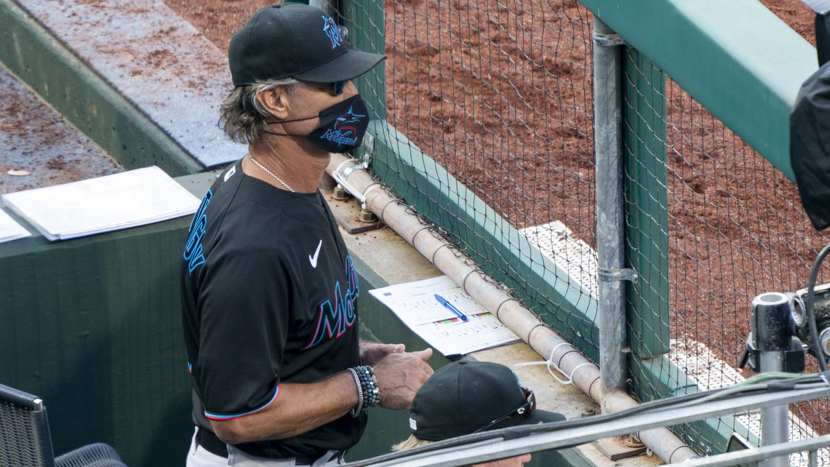 Miami Marlins' manager Don Mattingly looks out from the dugout during the eighth inning of a...