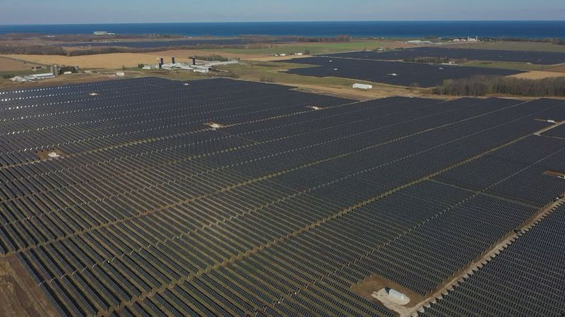 The facility features more than 500,000 solar panels across 800 acres.