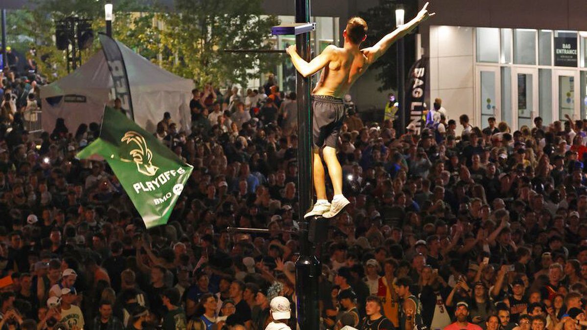 Fans watch Game 6 of the NBA basketball finals game between the Milwaukee Bucks and Phoenix...