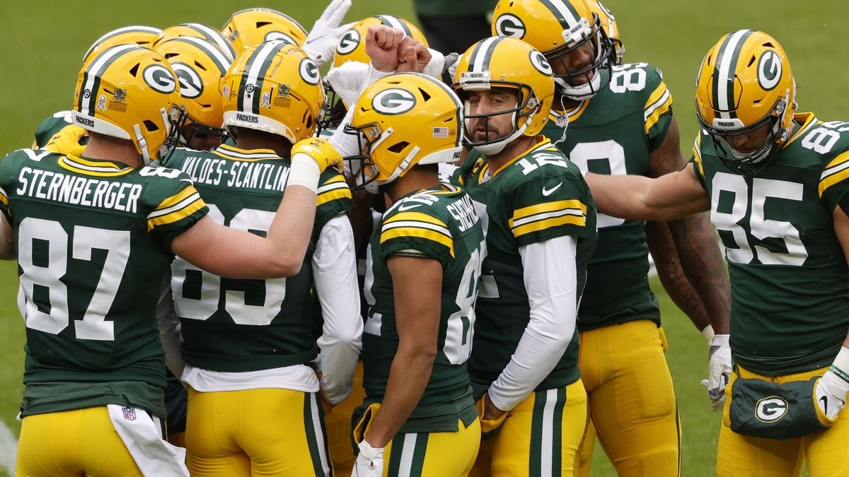 Green Bay Packers quarterback Aaron Rodgers (12) and his offense before an NFL football game,...