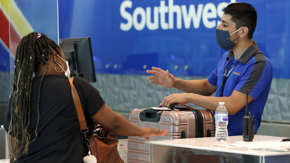 In this Wednesday, June 24, 2020, file photo, Southwest airlines employee Oscar Gonzalez,...