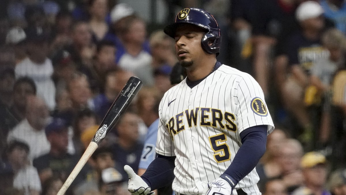 Milwaukee Brewers' Eduardo Escobar reacts after striking out against the Atlanta Braves during...