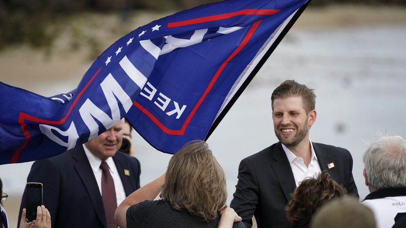 Eric Trump, the son of President Donald Trump, greets supporters at a campaign rally, Tuesday,...