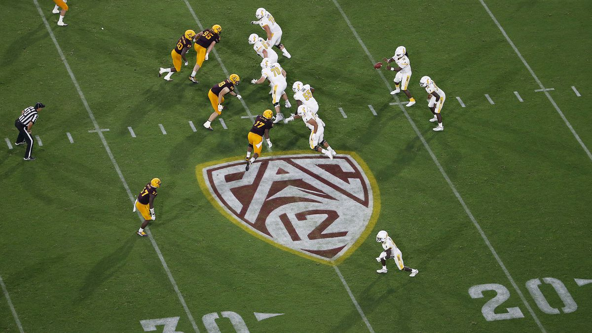 This Thursday, Aug. 29, 2019 file photo shows the Pac-12 logo during the second half of an NCAA...