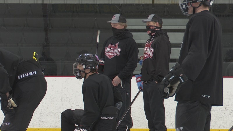Gary Suter (right) stands next his son Jake Suter (left) at a Lakeland Union hockey practice.