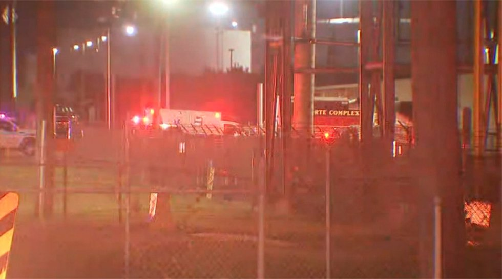 An ambulance is seen at the site of a plant leak in Laporte, Texas. Two people have died and...