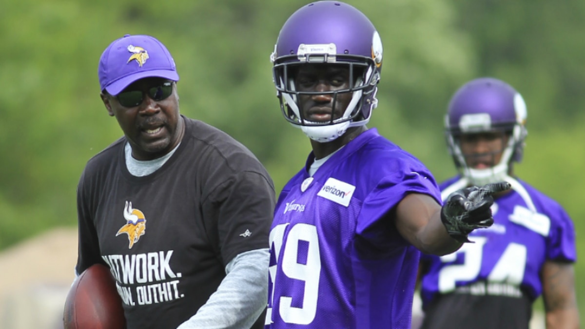 Minnesota Vikings safety Jack Tocho confers with defensive backs coach Jerry Gray during the NFL football team drills Tuesday, June 13, 2017, in Eden Prairie, Minn. (AP Photo/Andy Clayton-King)