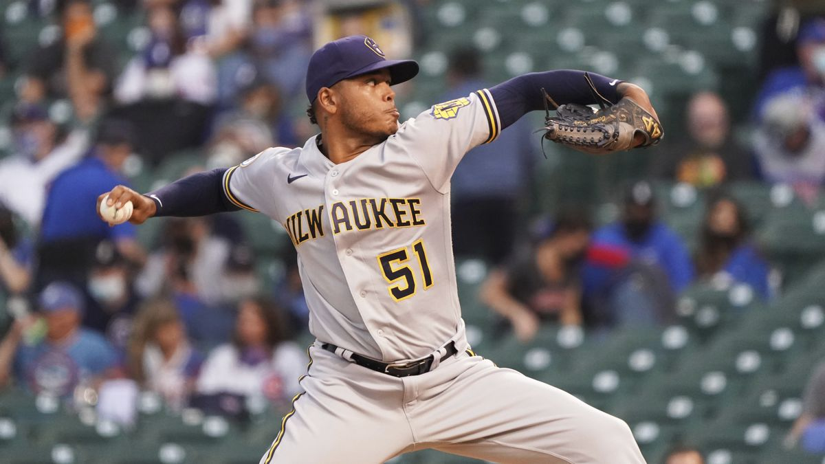 Milwaukee Brewers relief pitcher Freddy Peralta pitches against the Chicago Cubs during the...