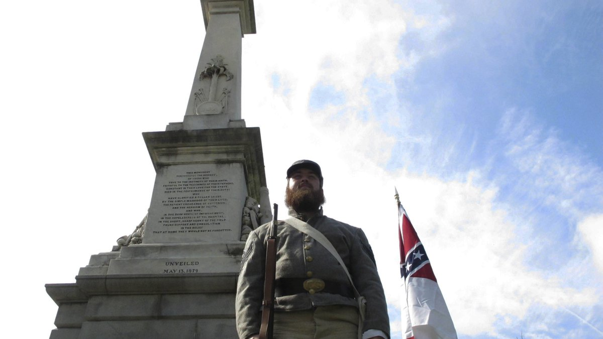 FILE - In this July 10, 2017, file photo, Cameron Maynard stands at attention by the monument...