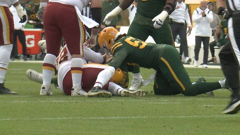 The Packers Dean Lowry recovers a fumble against the Washington Football Team on October 24,...