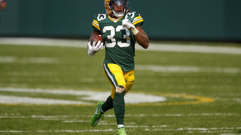 Green Bay Packers' Aaron Jones runs for a touchdown during the second half of an NFL football...