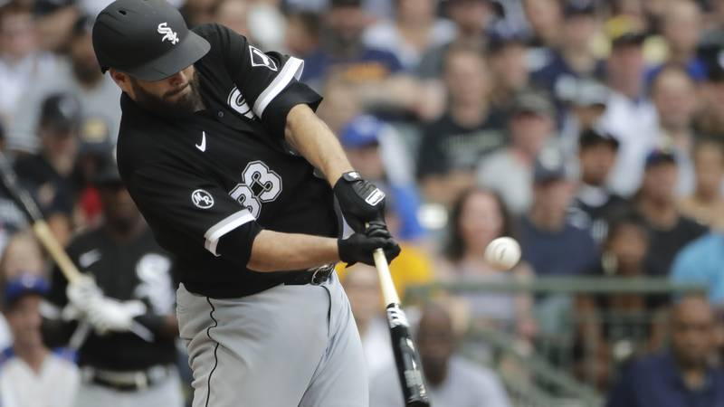 Chicago White Sox's Lance Lynn hits a two-run single during the second inning of a baseball...