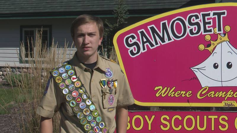 Michael Brierton displays his badges
