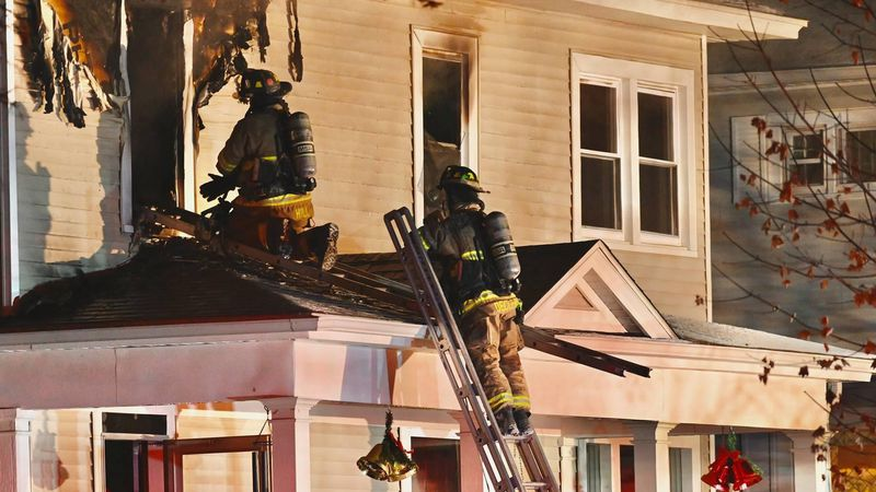 Crews from the Wausau Fire Department battle a house fire on the 800 block of Fulton St. on...
