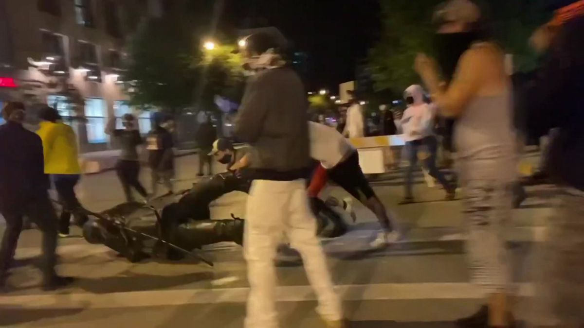 Downtown protesters drag the statue of Hans Christian Heg after tearing it down June 23, 2020.