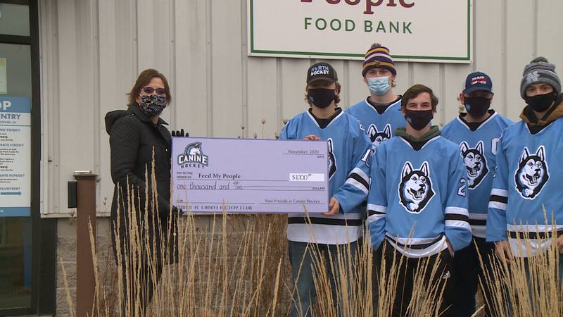 The North High School hockey team raised the money through their annual 25-mile bicycle ride,...