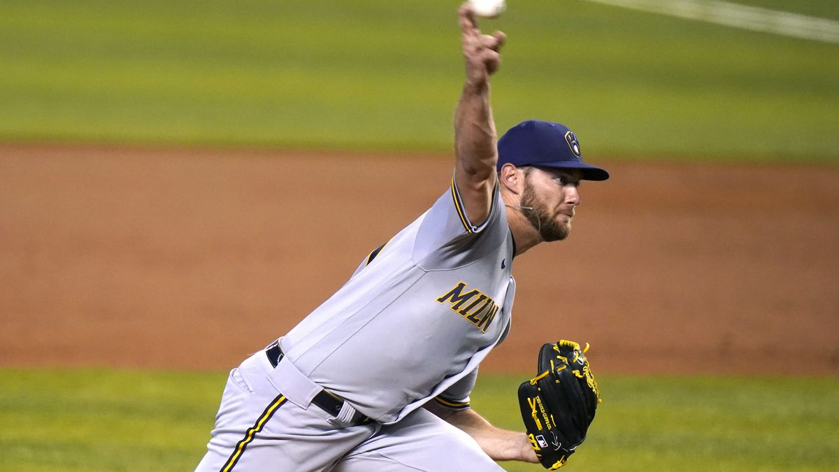 Milwaukee Brewers starting pitcher Adrian Houser throws during the first inning of a baseball...