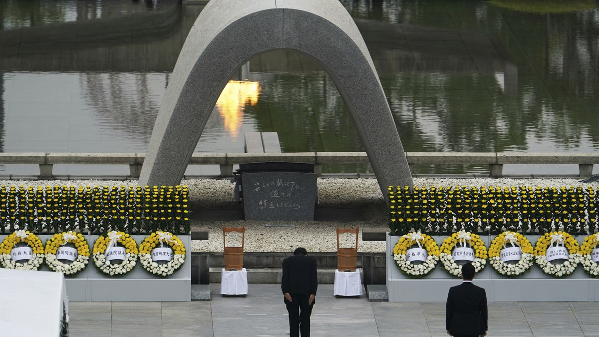 Japanese Prime Minister Shinzo Abe bows in front of Hiroshima Memorial Cenotaph during a...