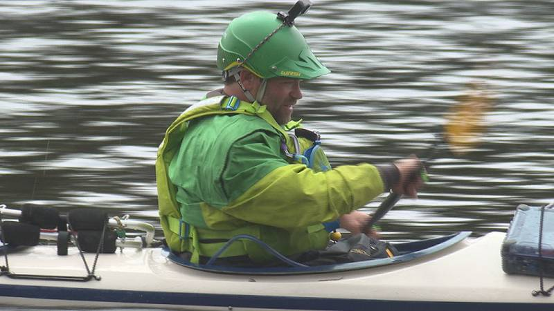 Jason Pientka paddles at mile 100 along the Wisconsin River in Tomahawk.