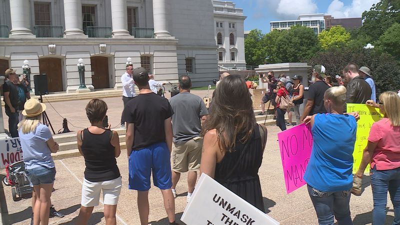 Dozens of protestors gathered below Gov. Evers's office as they send their message