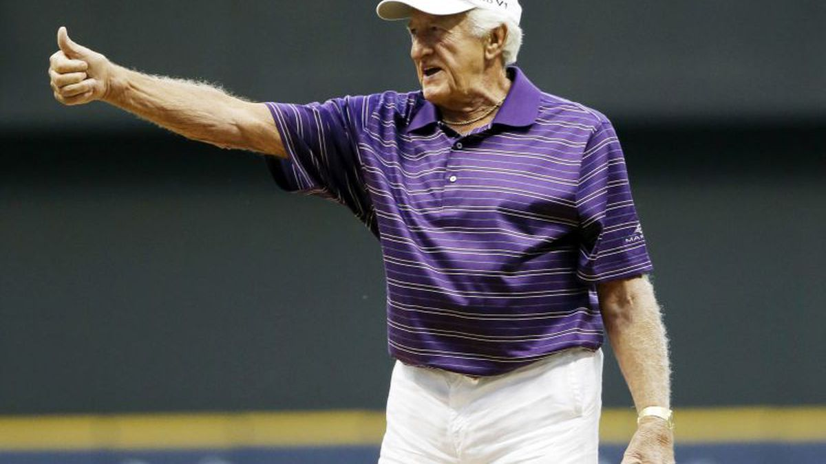 Bob Uecker throws out the ceremonial first pitch before a baseball game between the Milwaukee...