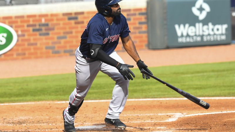 Boston Red Sox' Jackie Bradley Jr. watches his line drive soar to center field for a home run...