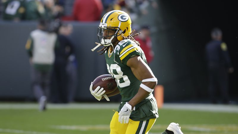Green Bay Packers' Tramon Williams runs before an NFL football game against the Oakland Raiders...