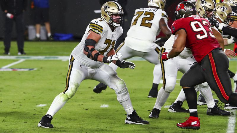 New Orleans Saints offensive tackle Ryan Ramczyk (71) pass blocks during the first half of an...