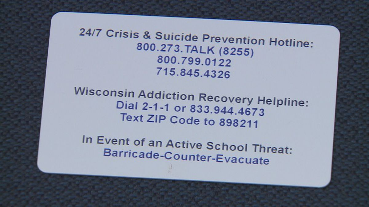 Crisis numbers printed on back of student ID cards (WSAW photo)