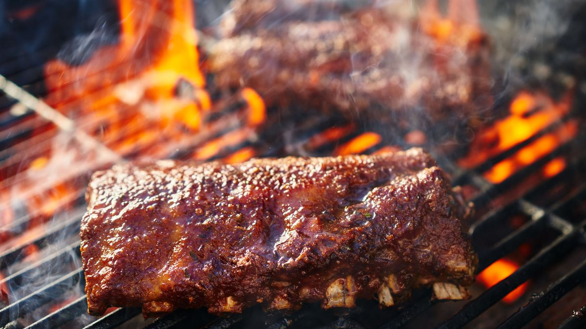 67182121 - grilling barbecue ribs on flaming grill