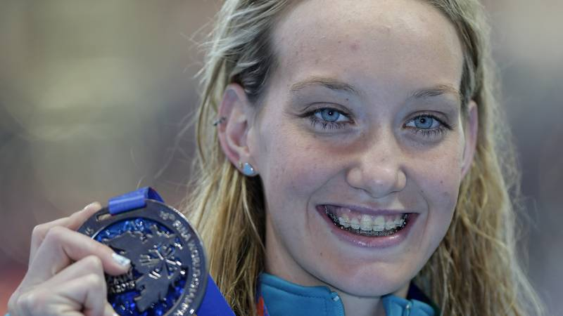 FILE - Australia's Madison Wilson holds her silver medal after her second place finish in the...