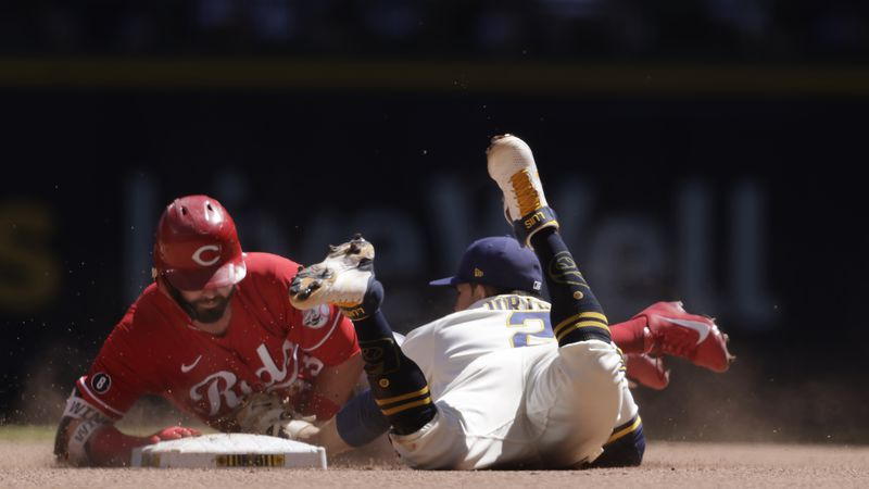 Cincinnati Reds right fielder Jesse Winker (33) is tagged out at second base by Milwaukee...