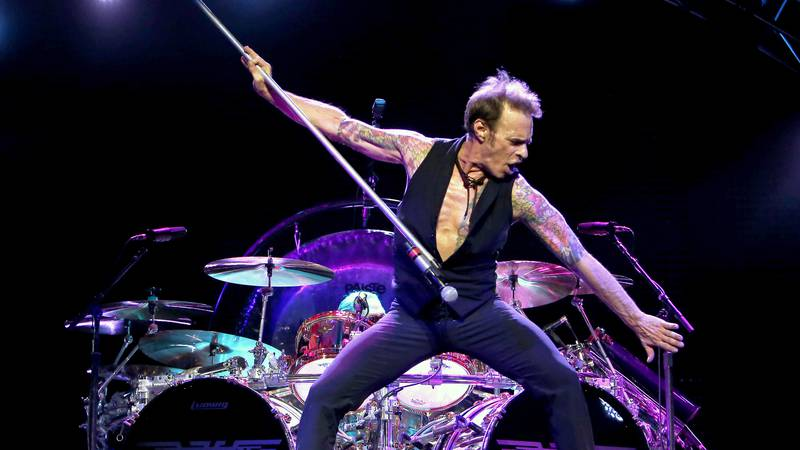 This Sept. 28, 2015, file photo shows David Lee Roth, the high-kicking lead singer of the rock...