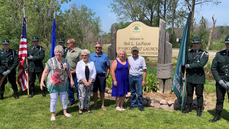 The family of Neil LaFave stands in front of the newly named Neil LaFave Suamico Boat Launch.