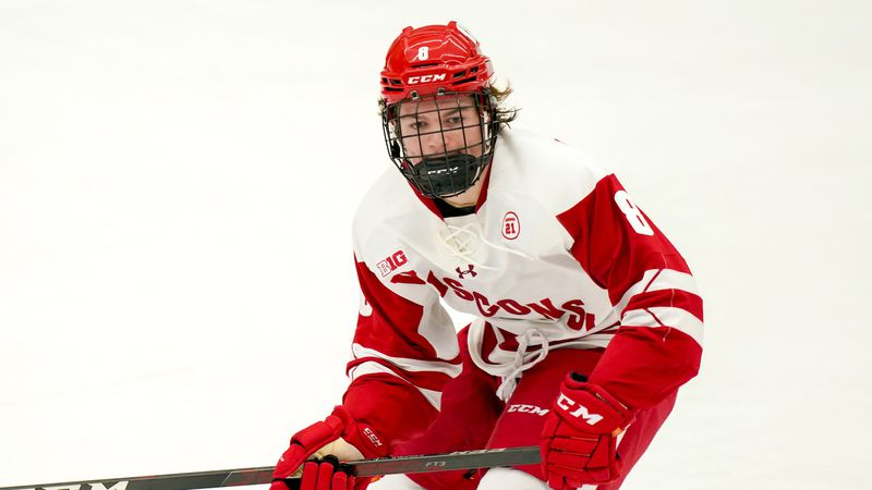 Wisconsin's Cole Caufield (8) during the first period of an NCAA college hockey game against...