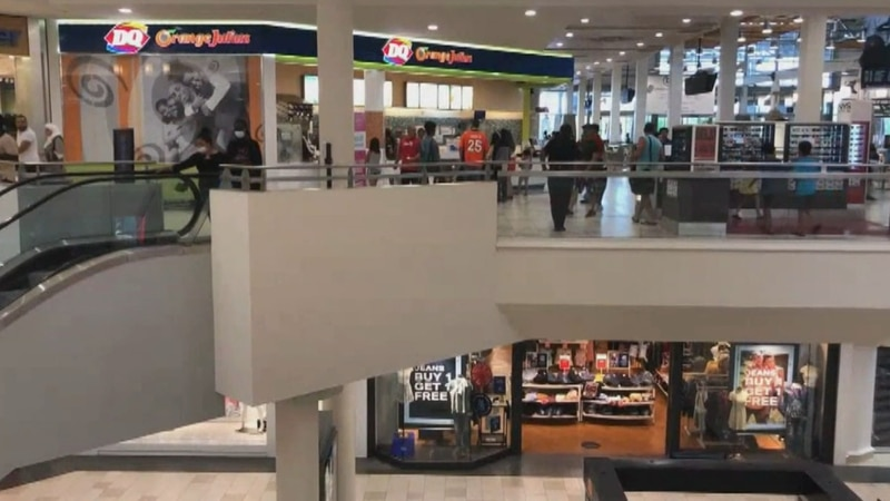 A toddler died after falling over an escalator at a mall.