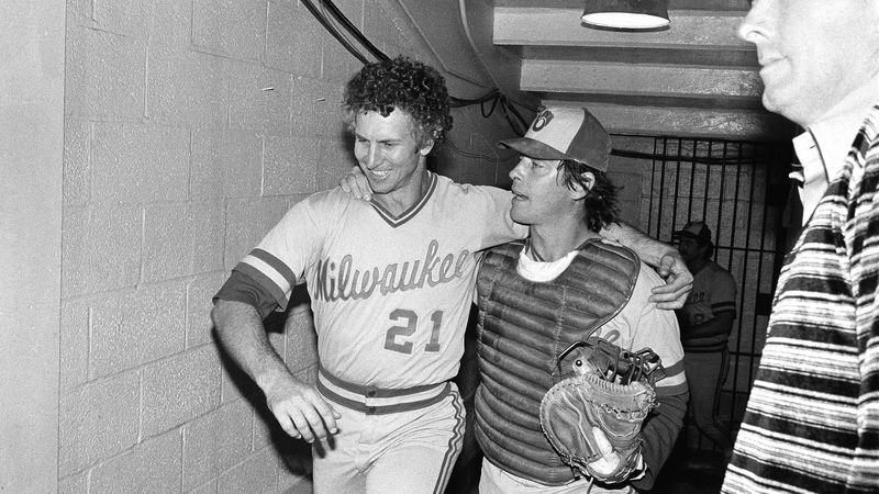 Winning pitcher Don Sutton is arm and arm with batterymate Ted Simmons as they walk to the...