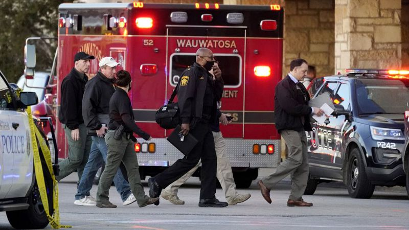 Police officials walk to the Mayfair Mall, Friday, Nov. 20, 2020, in Wauwatosa, Wis. Multiple...